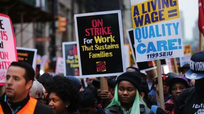 NEW YORK, NY - NOVEMBER 10: Low wage workers and supporters protest for a $15 an hour minimum wage on November 10, 2015 in New York, United States. In what organizers are calling a National Day of Action for $15 and hour minimum wage, thousands of people took to the streets across the country to stage protests in front of businesses that are paying some of their workers the minimum wage. Home care workers, employees in retail and fast food restaurants say that the current minimum is not a living wage. (Photo by Spencer Platt/Getty Images)