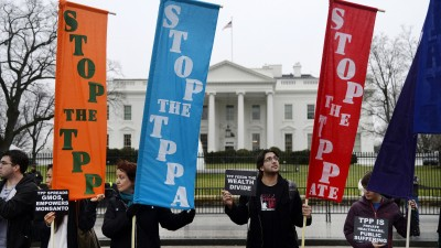 Activists hold a rally to protest the Trans-Pacific Partnership (TPP) in front of the White House on February 3, 2016 in Washington, DC. (Photo by Olivier Douliery/Getty Images)