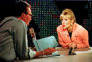 Gennifer Flowers (right) blows a kiss to talk show host Larry King (left) during her live interview on CNN's <em><p class=
