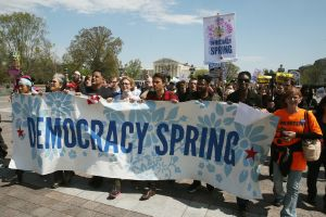 Democracy Spring protesters with banner