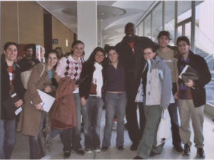 Democracy Matters interns with the organization's founder, Adonal Foyle.