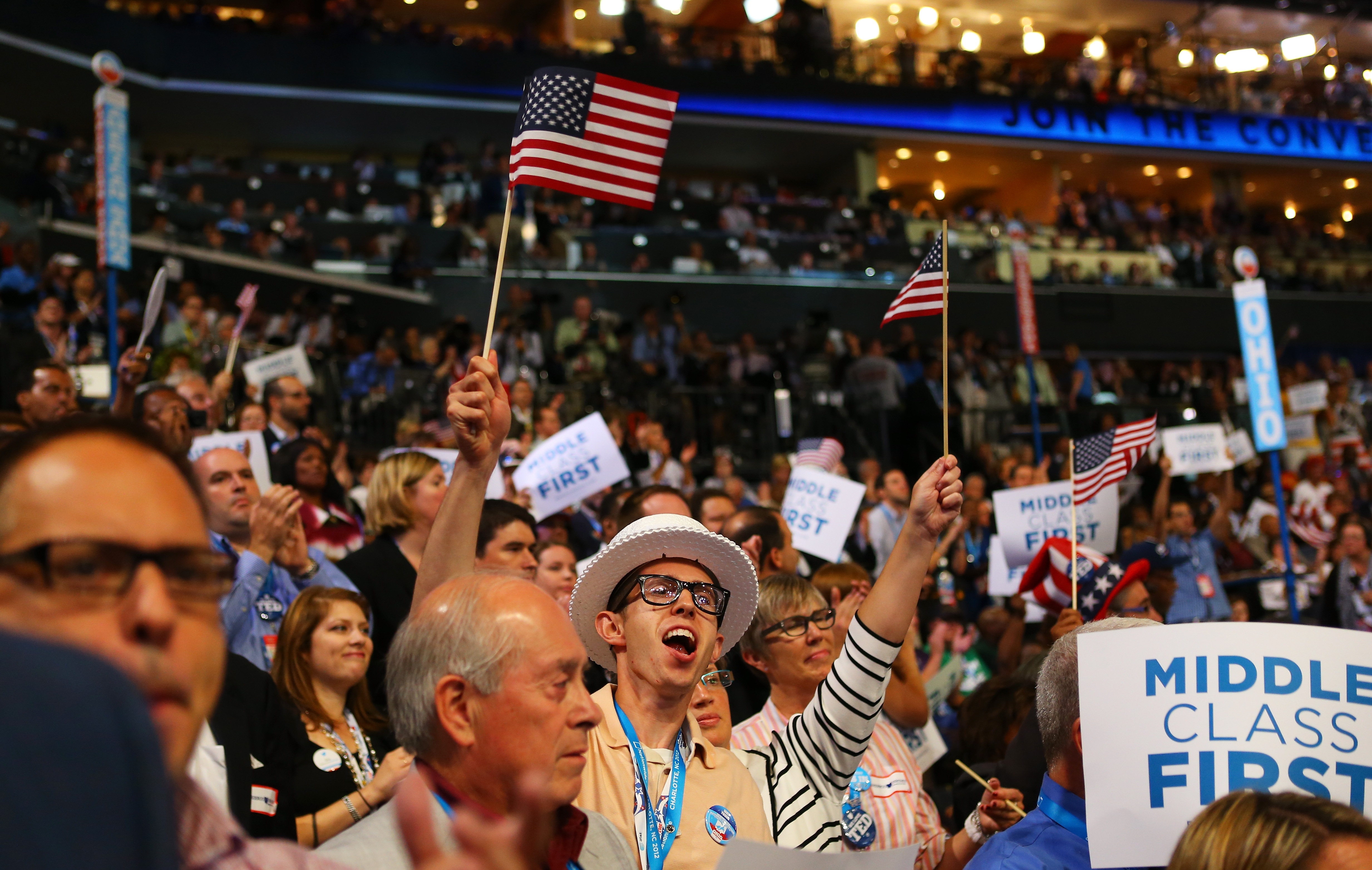 A cheering crowd watches President Bill Clinton address day two of the 2012 Democratic National Convention in Charlotte, North Carolina. (Photo by Joe Raedle/Getty Images)
