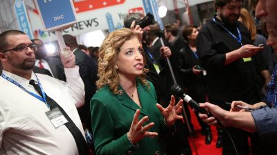 House Rep. Debbie Wasserman Schultz (D-FL), chair of the Democratic National Committee, speaks to reporters in the spin room after Democratic presidential debate at the Gaillard Center on January 17, 2016 in Charleston, South Carolina. (Photo by Andrew Burton/Getty Images)