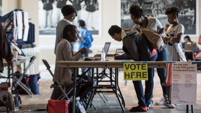 COLUMBIA, SC - FEBRUARY 27: Jennifer Robison, center, signs in to vote in the South Carolina Democratic presidential primary at the Prince of Orange Mall February 27, 2016 in Orangeburg, South Carolina. Voters in 12 states and one U.S. territory will participate in Super Tuesday on March 1. (Photo by Sean Rayford/Getty Images)