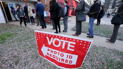 Virginia voters line up to cast their ballots in Arlington, Virginia, on Super Tuesday, March 1, 2016. Virginia is one of 17 states with new voting restrictions in 2016, requiring voters to present photo ID to cast their ballots. (Photo by Chip Somodevilla/Getty Images)