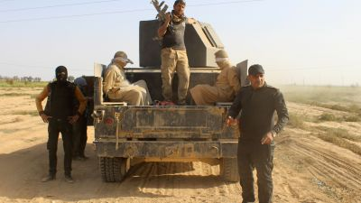 """Iraqi government and counter-terrorism forces arrest men suspected of belonging to the Islamic State (IS) jihadist group on March 10, 2016 following an operation to retake the town of Zankura, northwest of Ramadi, in Anbar province, from IS. Iraqi forces retook a town from the Islamic State jihadist group in Anbar province Thursday and evacuated 10,000 civilians as they advanced up the Euphrates valley, a security spokesman said. The sprawling province of Anbar -- which borders Syria, Jordan and Saudi Arabia -- was at the heart of the """"caliphate"""" that IS proclaimed in 2014. The jihadist group still holds most of the province but the noose is tightening around some of its key bastions. (MOADH AL-DULAIMI/AFP/Getty Images)"""