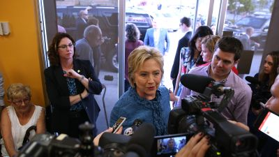 Democratic presidential candidate Hillary Clinton talks to members of the media during a visit to a Dunkin' Donuts on March 15, 2016 in West Palm Beach, Florida. (Photo by Justin Sullivan/Getty Images)