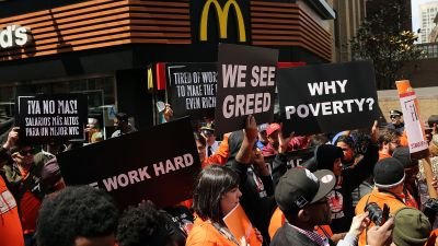 Low-wage workers, many in the fast-food industry, join with supporters in front of a New York City McDonald's to demand a minimum wage of $15 an hour. Home care workers, and employees at Walmart and fast food restaurants say that the current minimum is not a living wage. (Photo by Spencer Platt/Getty Images)