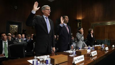 Federal Communications Commission (FCC) Chairman Thomas Wheeler and FCC Commissioner Ajit Pai are sworn in during a hearing before the Privacy, Technology and the Law Subcommittee of Senate Judiciary Committee, May 11, 2016. (Photo by Alex Wong/Getty Images)