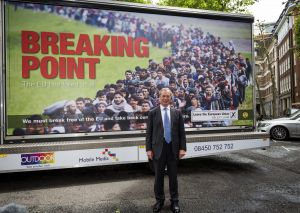 Leader of the United Kingdom Independence Party (UKIP) Nigel Farage poses with the party's new EU referendum poster on June 16 in London. (Photo by Jack Taylor/Getty Images)