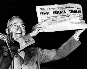 A victorious President Harry S Truman holds up a copy of the Chicago Daily Tribune that wrongly bannered his defeat. (Photo by Popperfoto/Getty Images)