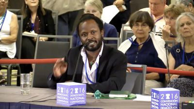 Anthony Rogers-Wright of the group Environmental Action speaks before the Democratic platform drafting committee.