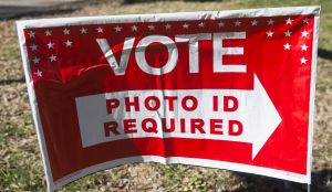 Polling place sign alerting voters 'photo ID required.'