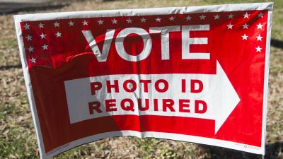 """Polling place sign alerting voters """"photo ID required."""""""