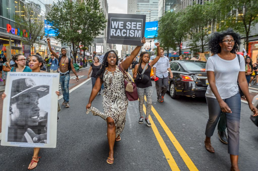 About 2,000 New Yorkers marched in Manhattan, bringing traffic to a halt for hours in a demonstration demanding police accountability and remembering Delrawn Small, Alton Sterling and Philando Castile, the three men recently shot dead by police. (Photo by Erik Mcgregor/Pacific Press/LightRocket via Getty Images)