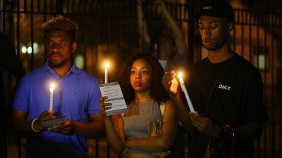 People attend a vigil in Harlem, July 8, 2016. (Photo by Volkan Furuncu/Anadolu Agency/Getty Images)