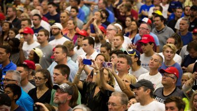 Campaign supporters await the arrival of Republican presidential nominee Donald Trump during a campaign rally in Westfield, Indiana. (Photo by Tasos Katopodis/AFP/Getty Images)