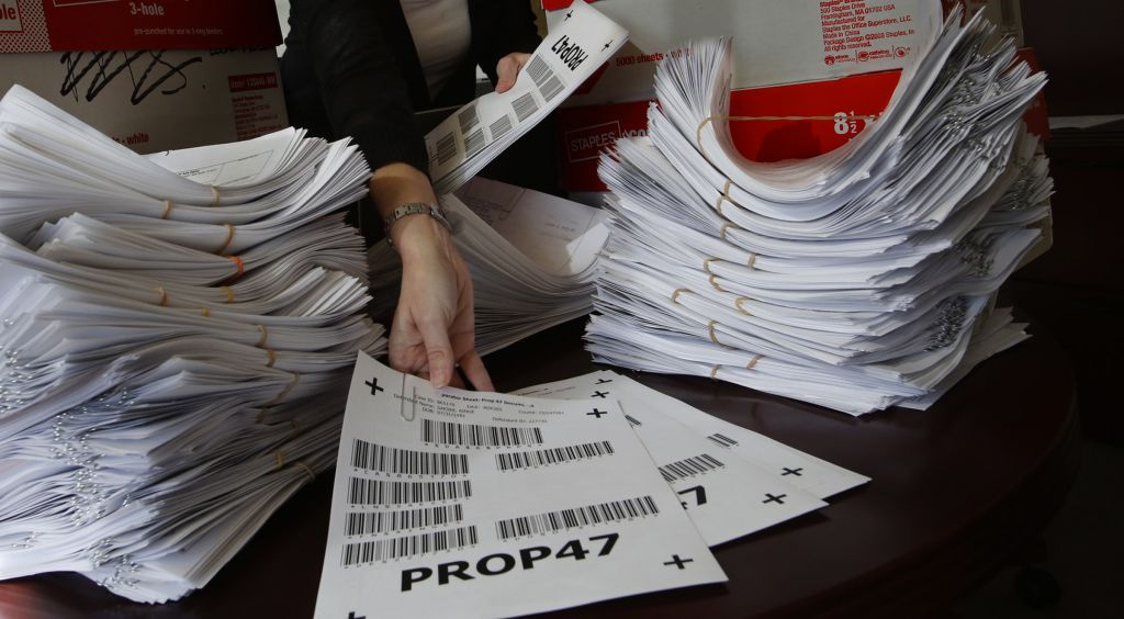 The deputy district attorney with the County of San Diego with 4,800 petitions for Proposition 47, which addresses criminal sentencing. (Photo by Don Bartletti/Los Angeles Times via Getty Images)