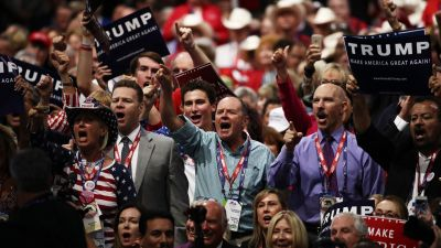 """Delegates yell """"guilty"""" as they participate during New Jersey Gov. Chris Christie's speech on the second day of the Republican National Convention on July 19, 2016 at the Quicken Loans Arena in Cleveland. (Photo by Win McNamee/Getty Images)"""