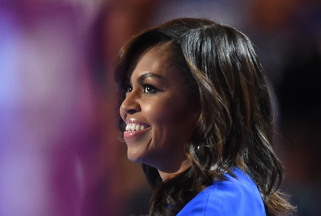First lady Michelle Obama speaks on the first day of the Democratic National Convention, July 25, 2016, at the Wells Fargo Center in Philadelphia. (Photo by Robyn Beck/AFP/Getty Images)