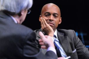 Bill Moyers interviews Dr. Khalil Gibran Muhammad, outgoing director of the Schomburg Center for Research in Black Culture. (Photo by Bob Gore)