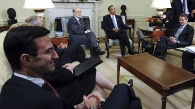 President Barack Obama, second from right, speaks to the media after meeting with his economic advisers in the Oval Office of the White House in Washington, DC, on Tuesday, June 29, 2010. Sitting from left are, Peter Orszag, the White House budget director, Ben S. Bernanke, chairman of the US Federal Reserve, Obama and Timothy Geithner, US treasury secretary. (Photographer: Roger L. Wollenberg/Pool via Bloomberg)