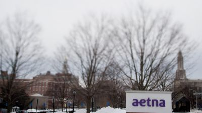 Snow covers the ground around Aetna Inc. signage displayed outside of the company's corporate headquarters in Hartford, Connecticut, on Friday, Feb. 6, 2015. (Photographer: Ron Antonelli/Bloomberg via Getty Images)