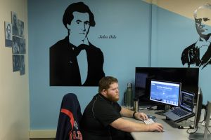 Former coal miner working as computer coder.