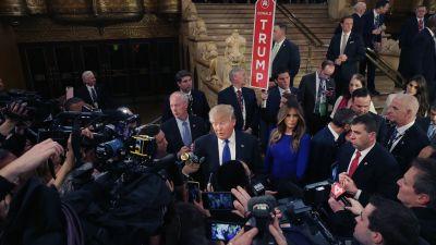 Donald Trump talks to the media