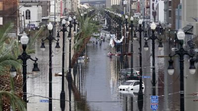 Canal Street is flooded a day after Hurricane Katrina blew through Aug. 30, 2005 in New Orleans. Today, nearly 1 in 3 black residents have not returned to the city after the storm. (Photo by Chris Graythen/Getty Images)