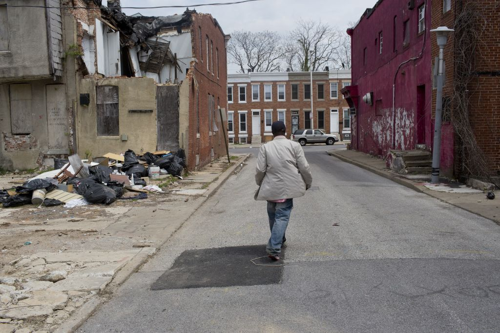 The streets of Northwest Baltimore are filled with abandoned houses. (Photo by Andrew Lichtenstein/Corbis via Getty Images)