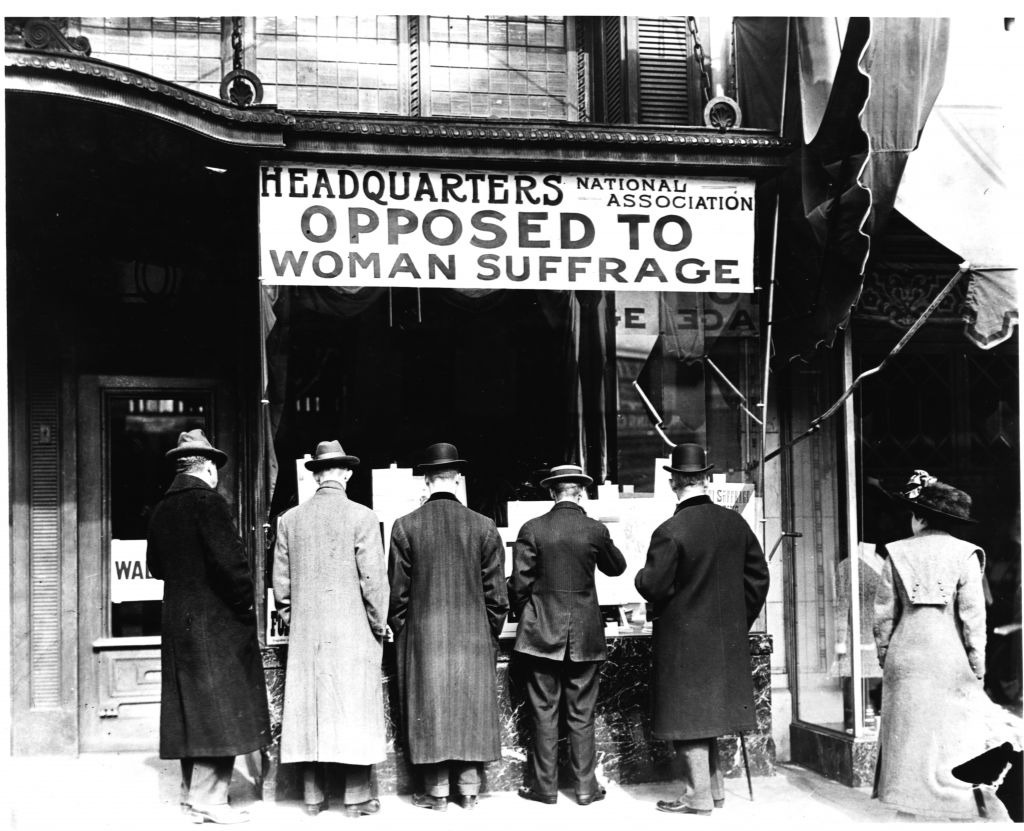 A group of men stand in front of the Headquarters National Association opposed to Woman Suffrage. USA. (Photo by Harris & Ewing, Inc./Library of Congress/Corbis/VCG via Getty Images)