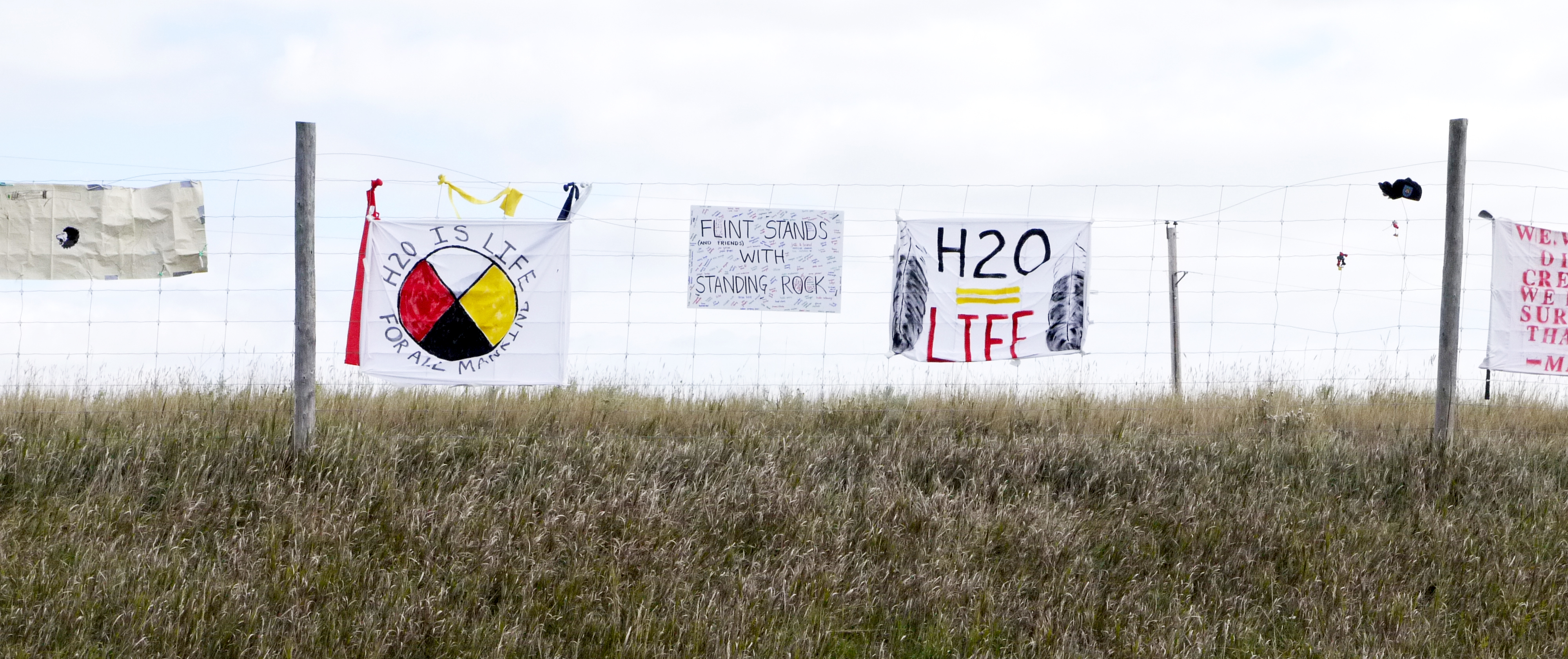 """A sign along the highway near the Dakota Access Pipeline construction site reads """"Flint Stands with Standing Rock."""" (Sarah Jaffe for BillMoyers.com)"""