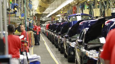 The 2012 Ford Focus moves down the assembly line during the launch of the small car at the Ford Motor Co. Michigan Assembly Plant in Wayne, Michigan, in 2011. Ford announced plans to move all of its small car production to Mexico. (Photo by Jeff Kowalsky/Bloomberg via Getty Images)