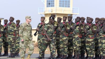 US Army Brigadier Gen. Donald Bolduc (left) and Senegal's Army Gen. Amadou Kane review the troops during the inauguration of a military base in Thies, 70 km from Dakar, on Feb. 8, 2016, the second day of a three-week joint military exercise between African, US and European troops, known as Flintlock. (Photo by Seyllou/AFP/Getty Images)