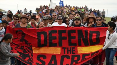 Native American protesters march to a sacred burial ground site that was disturbed by bulldozers building the Dakota Access Pipeline (DAPL) on Sept. 4, 2016. (Photo by Robyn Beck/AFP/Getty Images)