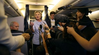 Democratic presidential nominee Hillary Clinton speaks to reporters on her campaign plane en route to Iowa Sept. 5, 2016. (Photo by Justin Sullivan/Getty Images)