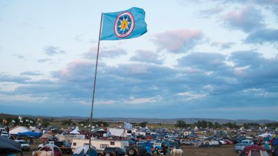 A Standing Rock Sioux flag flies over a protest encampment near Cannon Ball, North Dakota, where members of the Standing Rock Sioux tribe and their supporters have gathered to voice their opposition to the Dakota Access Pipeline. (Photo by Robyn Beck/AFP/Getty Images)