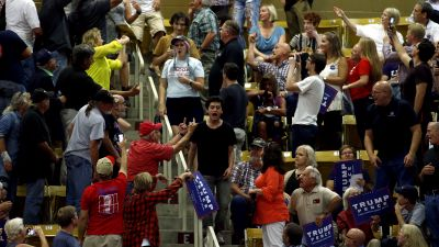 """The crowd reacts as hecklers are escorted out during a speech by Republican presidential candidate Donald Trump at a rally on September 12, 2016, at US Cellular Center in Asheville, North Carolina. Trump criticized Democratic rival Hillary Clinton for saying that half of his supporters belong in a """"basket of deplorables."""" (Photo by Brian Blanco/Getty Images)"""