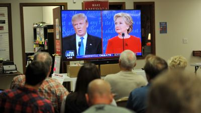 Supporters of Republican presidential nominee Donald Trump listen to the first of three presidential debates at the Trump headquarters in Urbandale, Iowa. (Photo by Steve Pope/Getty Images)
