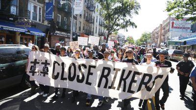 Activists march through Astoria, Queens, demanding that New York City's leaders close Rikers Island prison. (John Light/BillMoyers.com)
