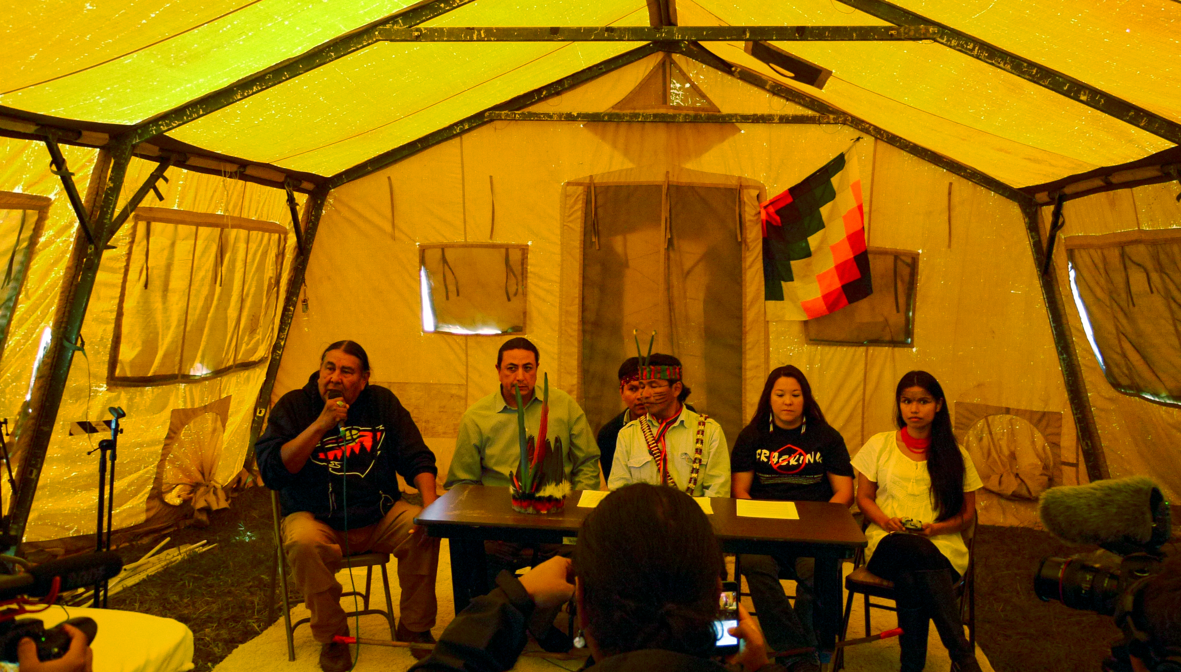A press conference with (from left to right) Tom Goldtooth of the Indigenous Environmental Network, Standing Rock Chairman Dave Archambault II, Ecuadorian environmental and indigenous rights activist Franco Viteri, Kandi Mossett of the Indigenous Environmental Network and Ecuadorian environmental and indigenous rights activist Nina Gualinga, Sept. 14, 2016. (Sarah Jaffe for BillMoyers.com)