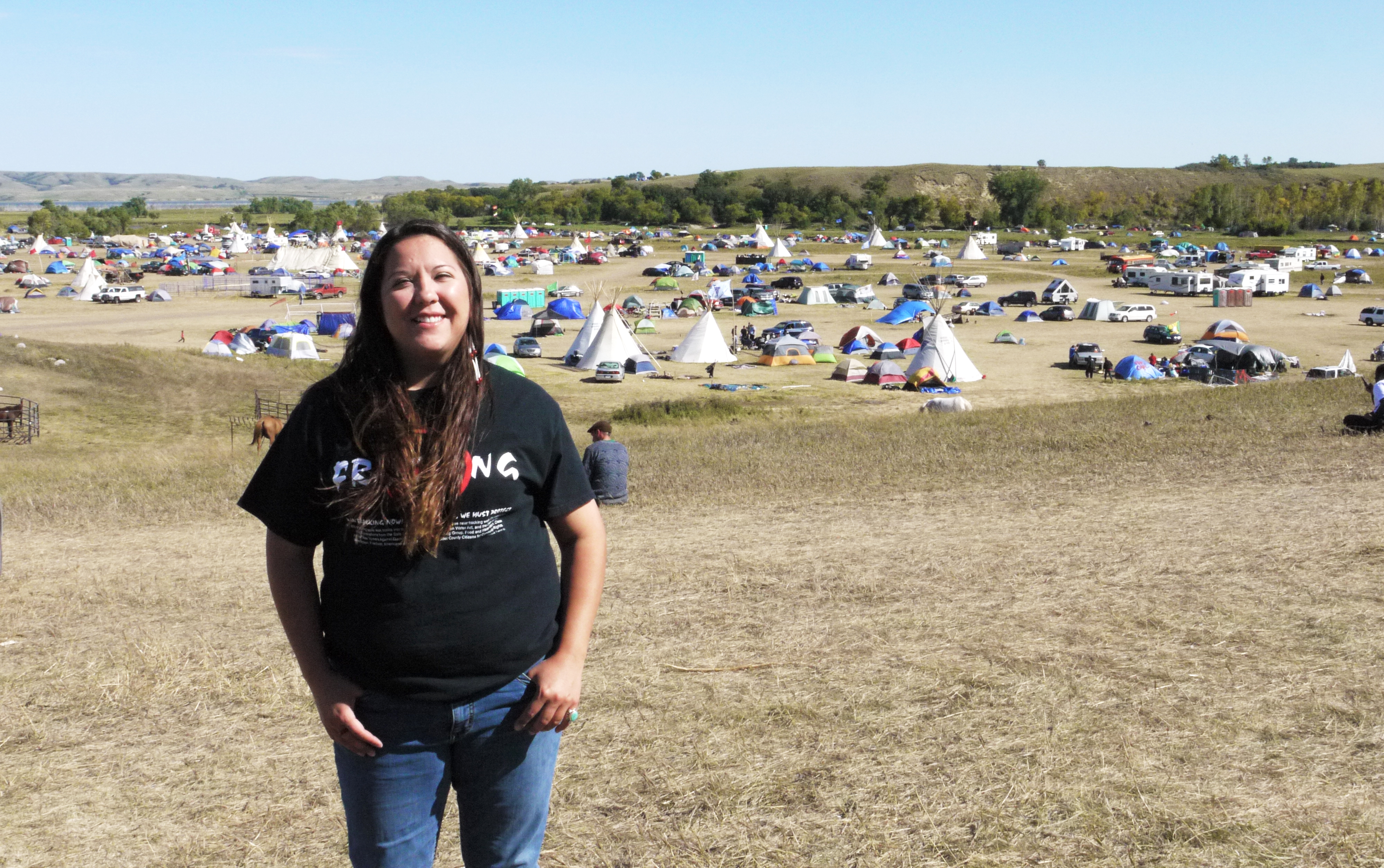 Kandi Mossett  on a hill overlooking the Oceti Sakowin camp. (Sarah Jaffe for BillMoyers.com)