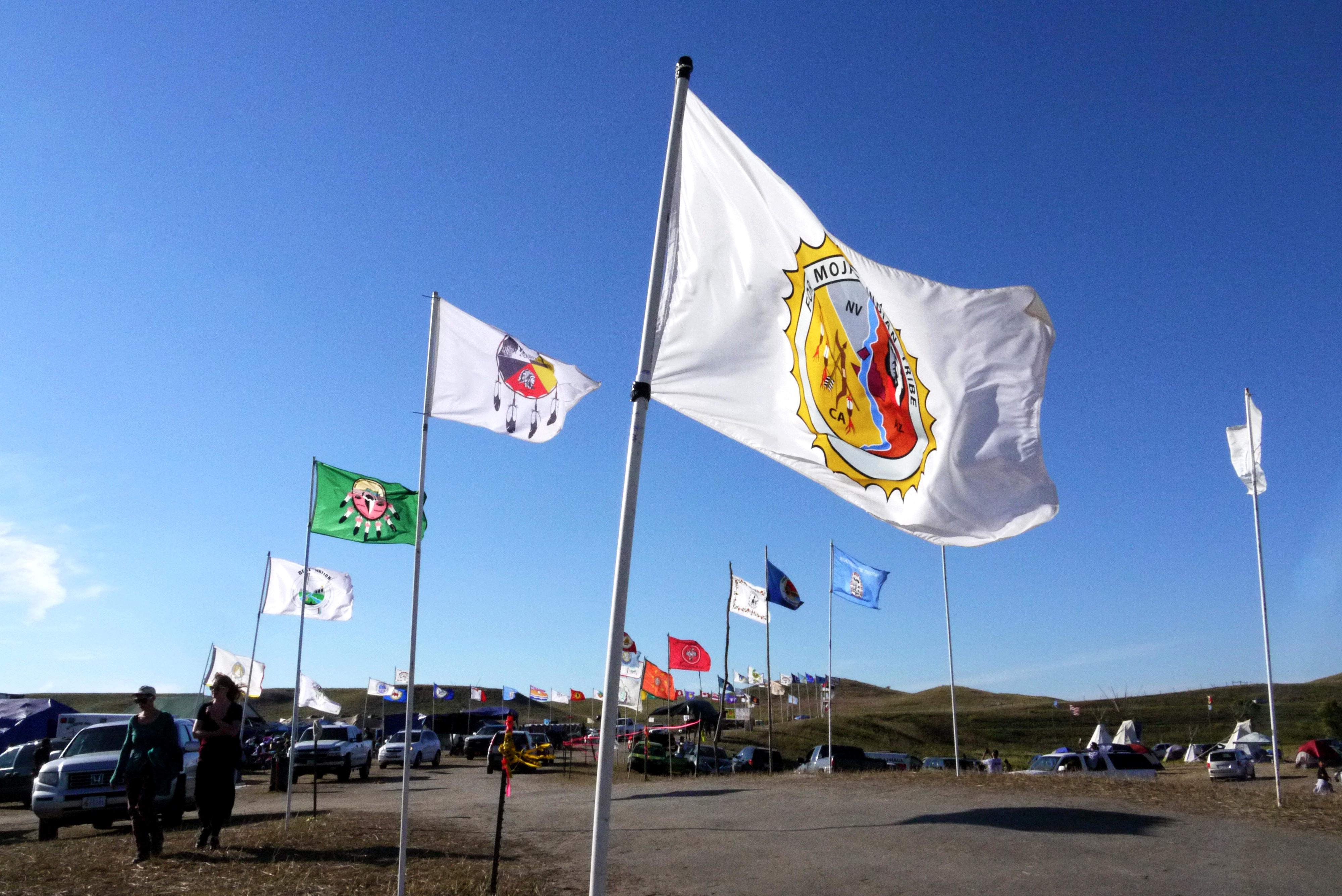 Flags at Oceti Sakowin camp, Sept. 14, 2016. (Sarah Jaffe for BillMoyers.com)