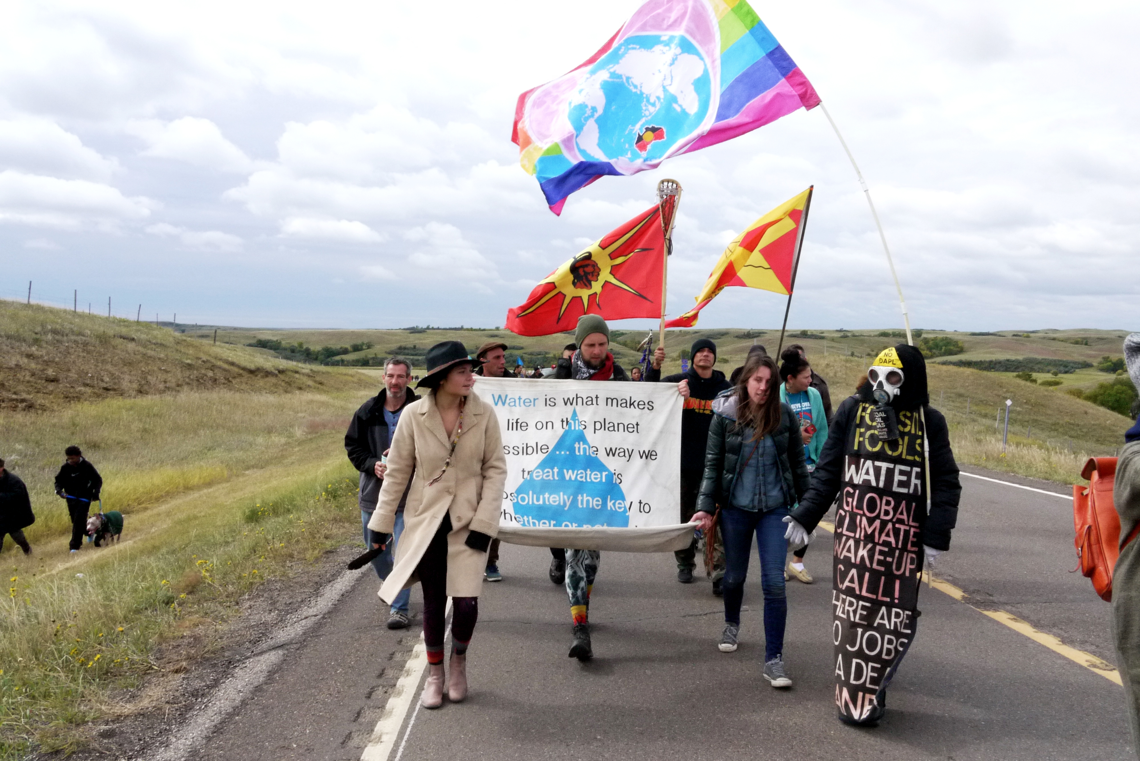 People from the Oceti Sakowin camp walking to the Dakota Access Pipeline construction site near the Missouri River, whose waters they say they are trying to protect, Sept. 13, 2016. (Sarah Jaffe for BillMoyers.com)