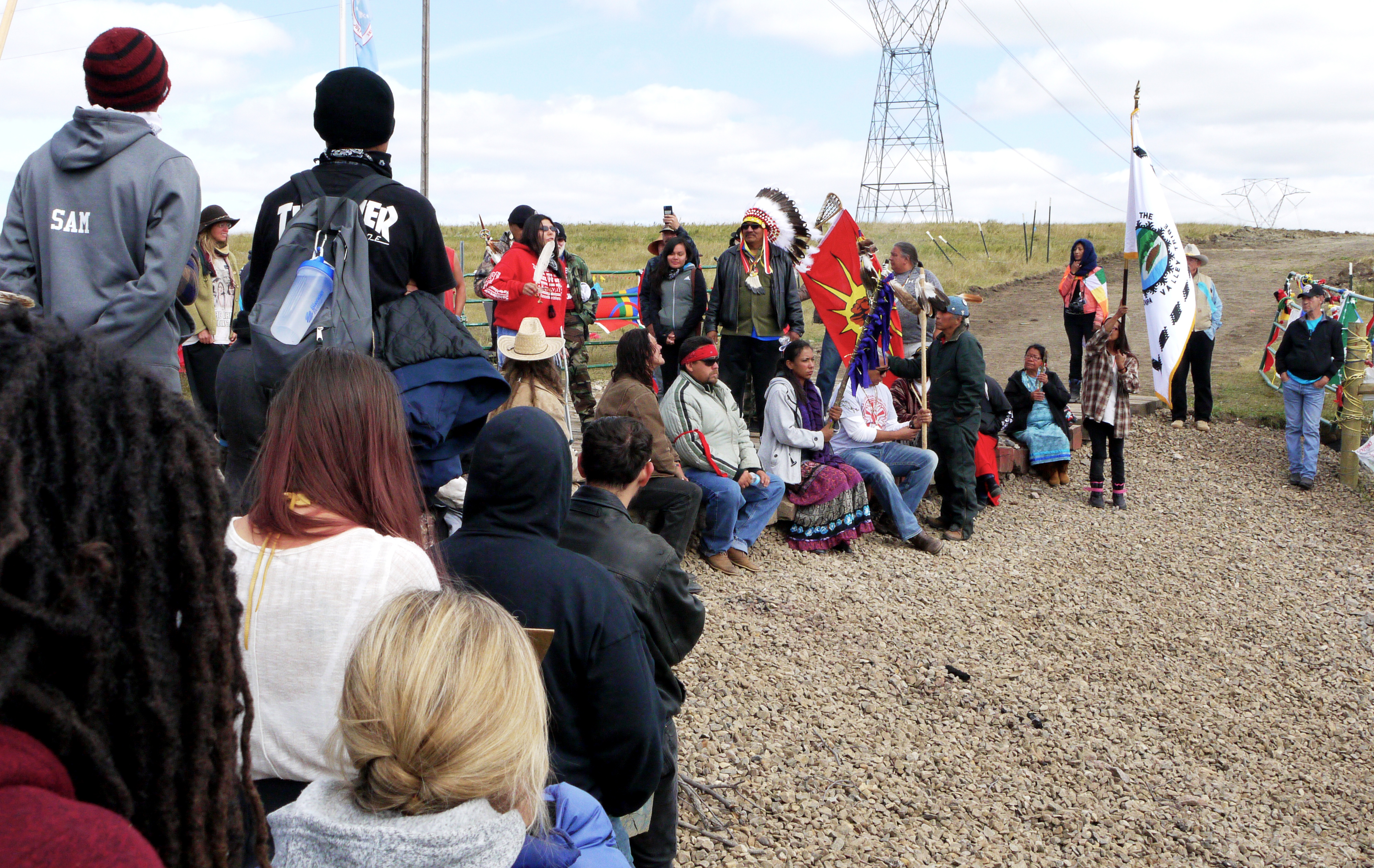 """A """"speak-out at the road to the Dakota Access Pipeline construction site, Sept. 13, 2016. (Sarah Jaffe for BillMoyers.com)"""