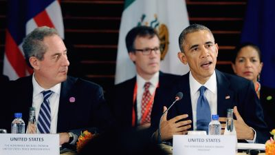 Barack Obama speaks while US Trade Representative Michael Froman listens during the Trans-Pacific Partnership (TPP) Summit meeting on the sidelines of the 2014 Asia Pacific Economic Cooperation (APEC). (Photo by The Asahi Shimbun via Getty Images)