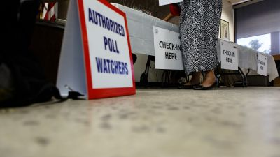 The GOP's voter-fraud crusade dates back to the 2000 election in Florida. That year, the state wrongly purged thousands of voters from the rolls. Now, poll watchers are stationed at polling places throughout the country, including this one in Washington, DC. (Photo by Keith Lane for The Washington Post via Getty Images)