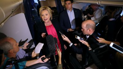 Hillary Clinton holds an informal press conference aboard her campaign plane.