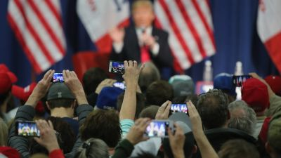 People photographing Donald Trump with their smartphones at a campaign rally in Council Bluffs, Iowa. (Photo by Christopher Furlong/Getty Images)